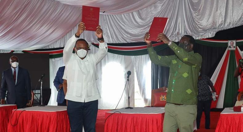 President Uhuru Kenyatta and Opposition Leader Raila Odinga receiving the final BBI Report