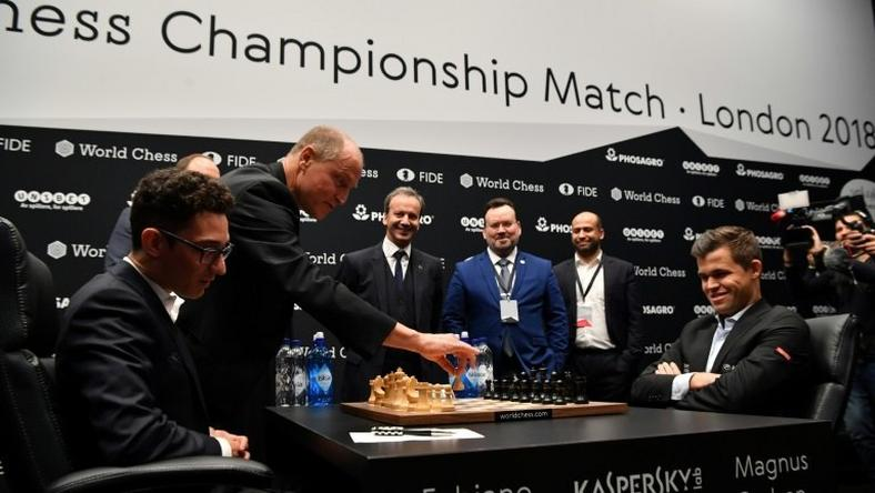 The 2018 World Chess Championship match got off to a comical start when Hollywood star Woody Harrelson misheard Fabiano Caruana's opening move against defending world champion Magnus Carlsen