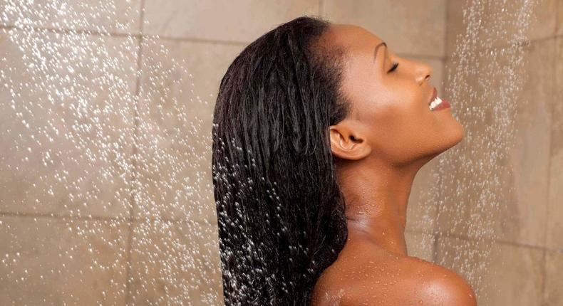 Black woman showering  (all things hair)