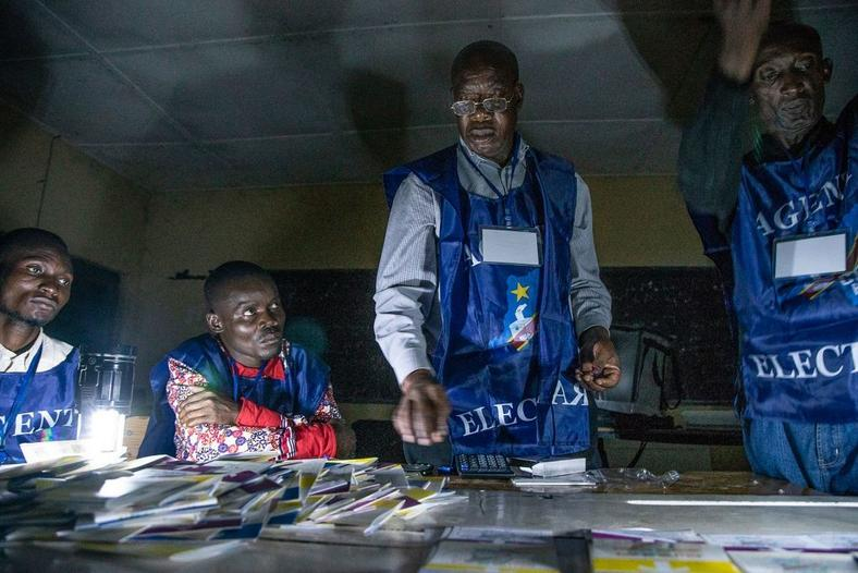Independent National Electoral Commission (CENI) agents count votes of the presidential election during an electricity cut in Lubumbashi, Democratic Republic of the Congo on Dec. 30, 2018.