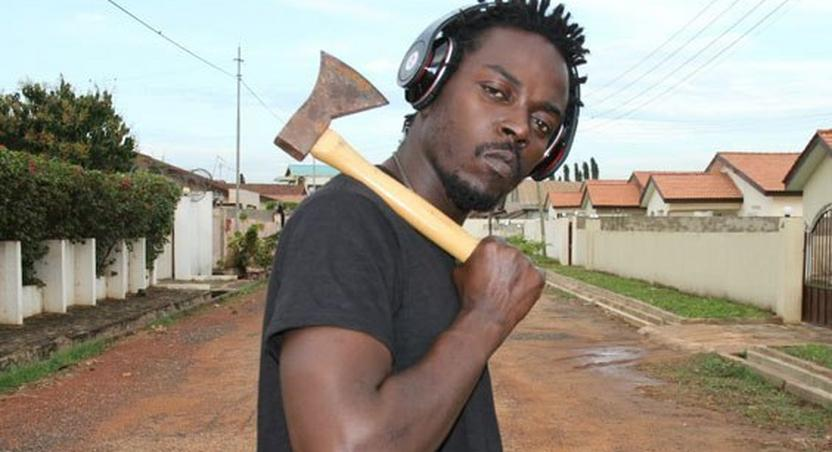 Kwaw Kese with an axe