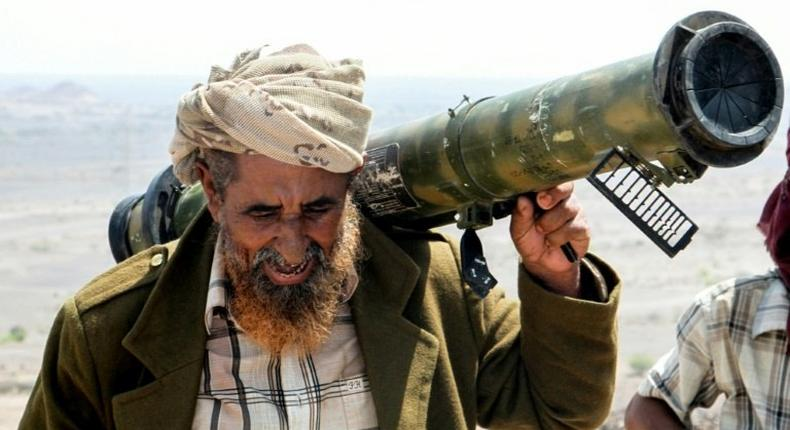 A fighter loyal to Yemen's Saudi-backed president, in the mountains outside the central city of Taez