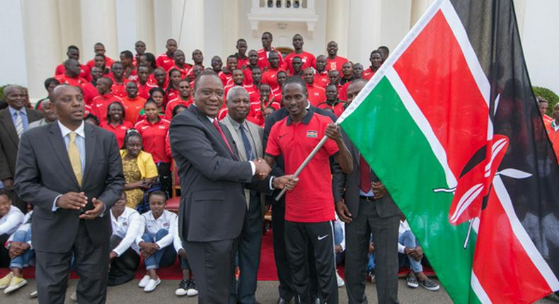 President Uhuru Kenyatta hands over flag to team that represented Kenya in the Commonwealth Games. 1972 Munich Olympics gold medalist Robert Ouko dies at age 70 in his Ngong home