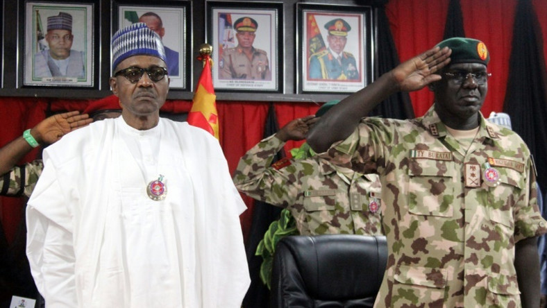 President Muhammadu Buhari and Chief of Army Staff Tukur Buratai during a function (Punch)