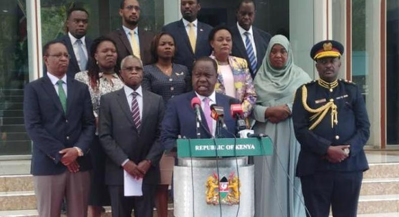 Interior CS Fred Matiang'i, Inspector General Hillary Mutyambai and NCIC led by Chairman Samuel Kobia addressing the media at Harambee House. Fatuma (standing behind Hillary Mutyambai) passed on Sunday, December 29 after collapsing at a wedding