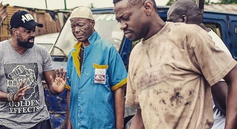 Kunle Afolayan dishing out instruction to Alabi yellow and Lateef Adedimeji on the set of  'Mokalik' [Instagram/KunleAfo]