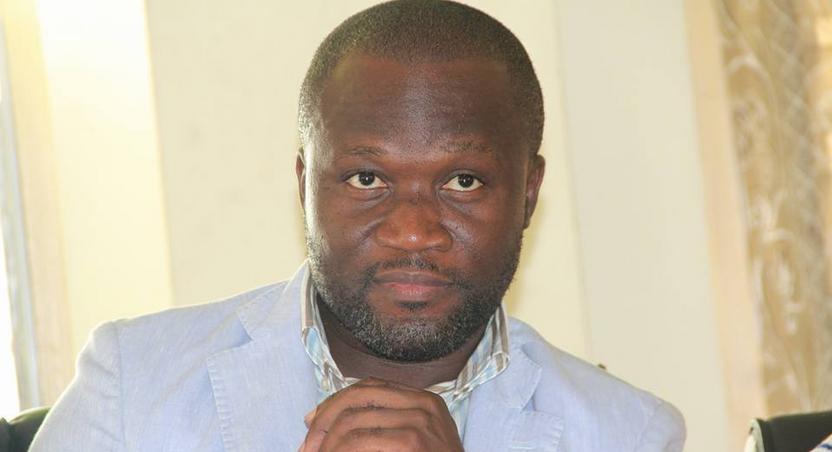 Michael Kweku Ola poses for the camera