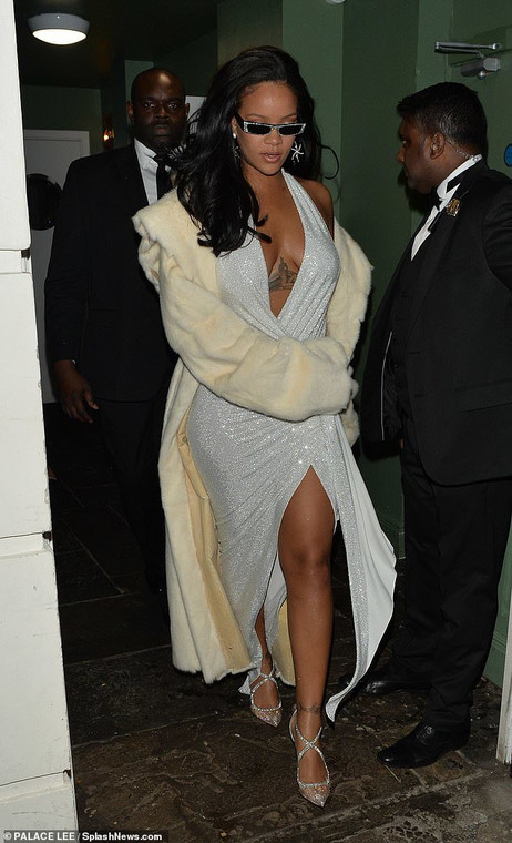Rihanna looking incredible in a plunging sparkly dress and matching accessories