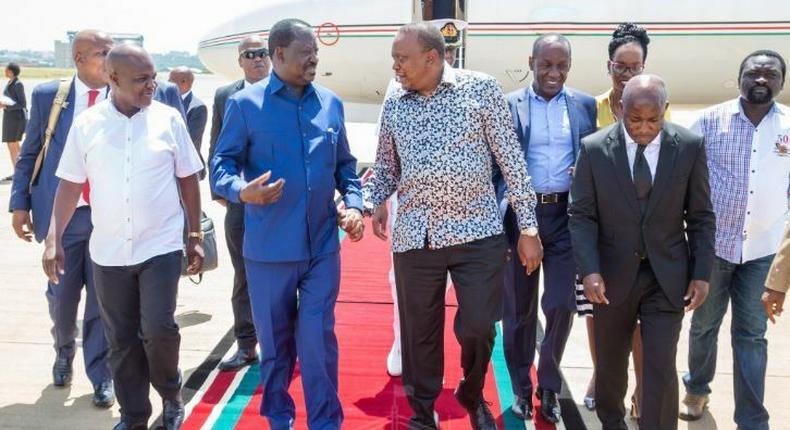 Raila Odinga and President Uhuru Keyatta arrive at Dr. Robert Ouko Primary School in Koru, Kisumu County for the funeral of the late Bruce Dominic Odhiambo Were