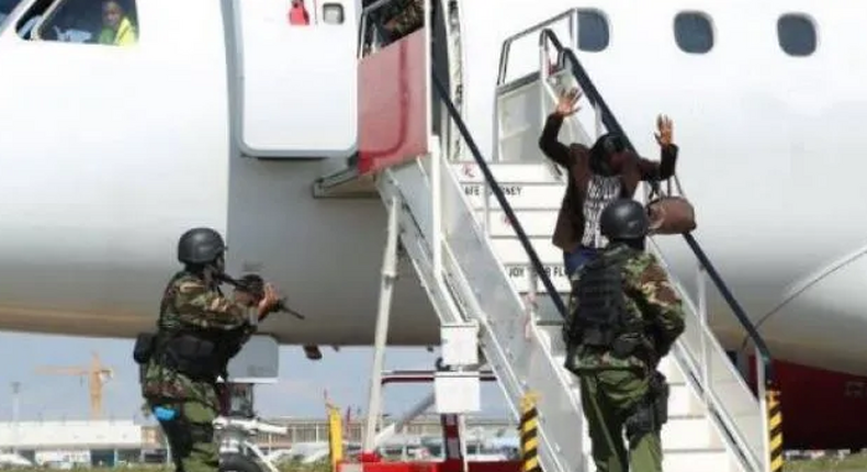 Police officers conducting a security drill at JKIA