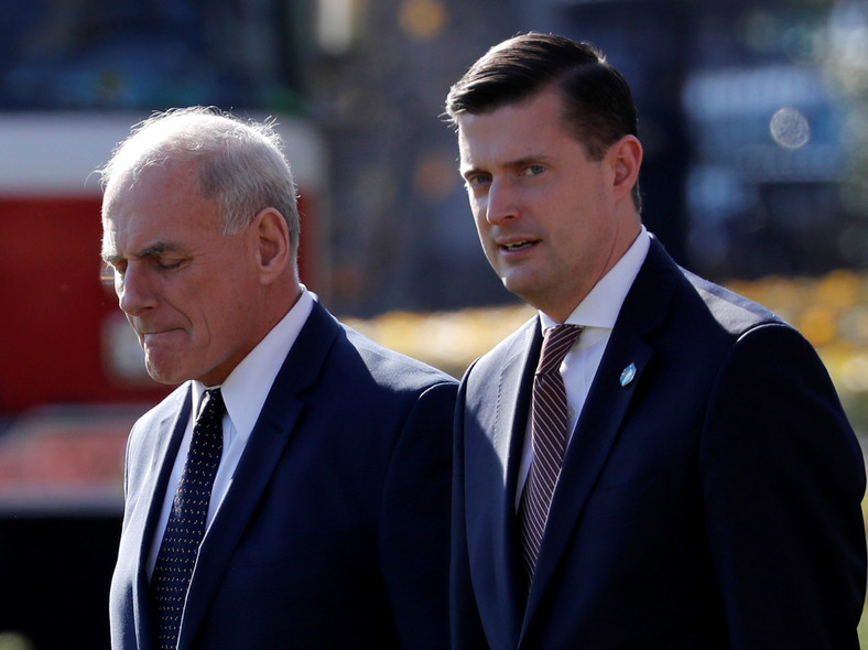 White House Chief of Staff John Kelly walks with former White House Staff Secretary Rob Porter.