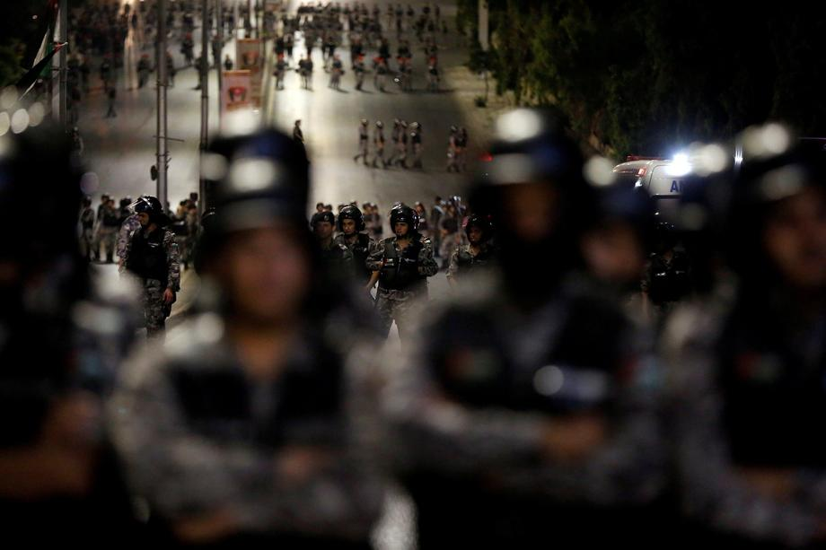 Policemen secure the main road near Jordan Prime Minister's office during a protest in Amman