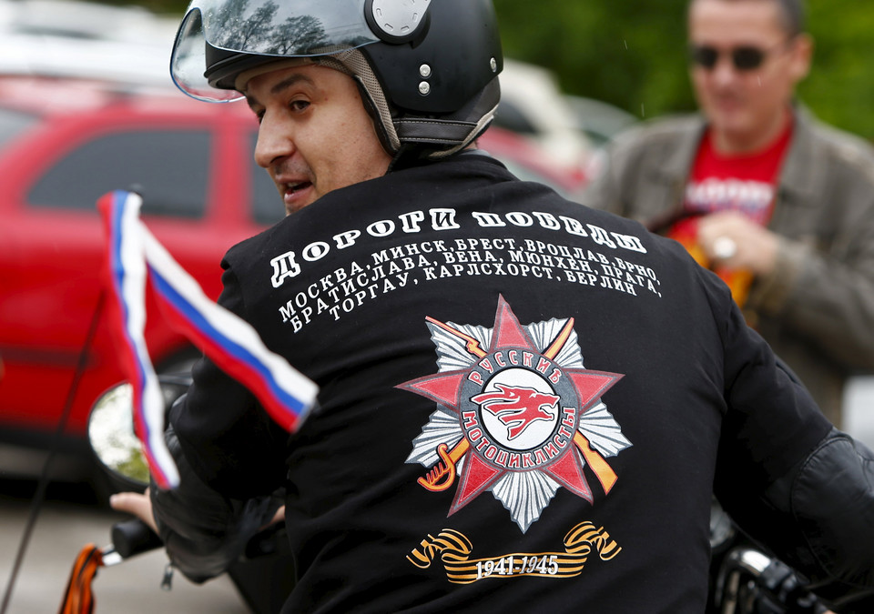 A member of the Russian motorcycle group called 'Nachtwoelfe' arrives at the parking space of the former German Nazi concentration camp in Dachau