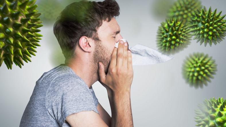 Mężczyzna atakowany przez wirusy, przeziębienie, grypa
