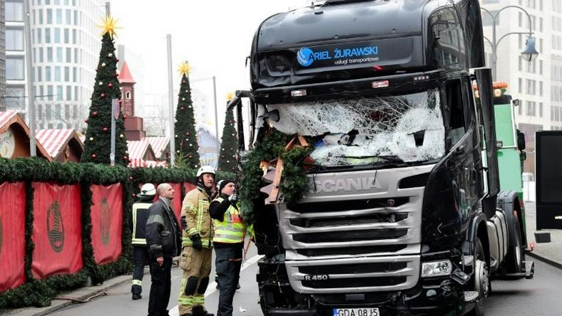 Investigators examine the truck that crashed the evening before into a Christmas market near Kaiser Wilhelm Memorial Church in Berlin, on December 20, 2016