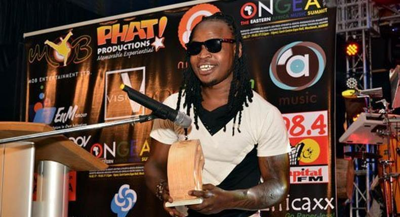 Rapper Timmy Tdat addresses fans after winning the Most Downloaded Hip Hop song in the Mdundo Music Awards.