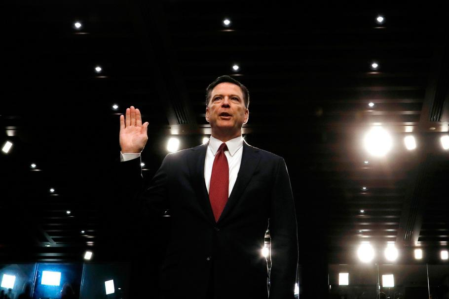 Former FBI Director James Comey sworn in to testify at a hearing in Washington
