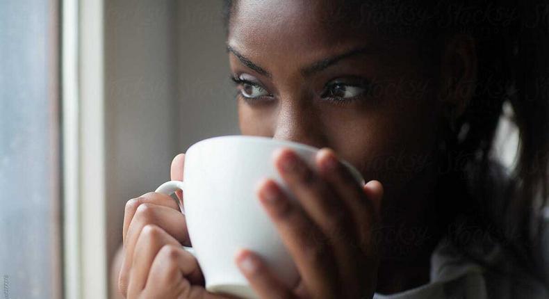 Black woman drinking tea [Stocksy]