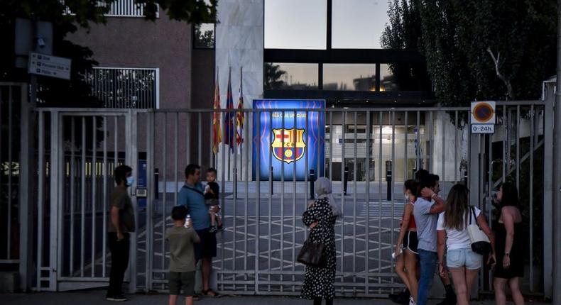 'Bombshell': Barcelona supporters gather in front of the Camp Nou stadium in Barcelona Creator: Pau BARRENA