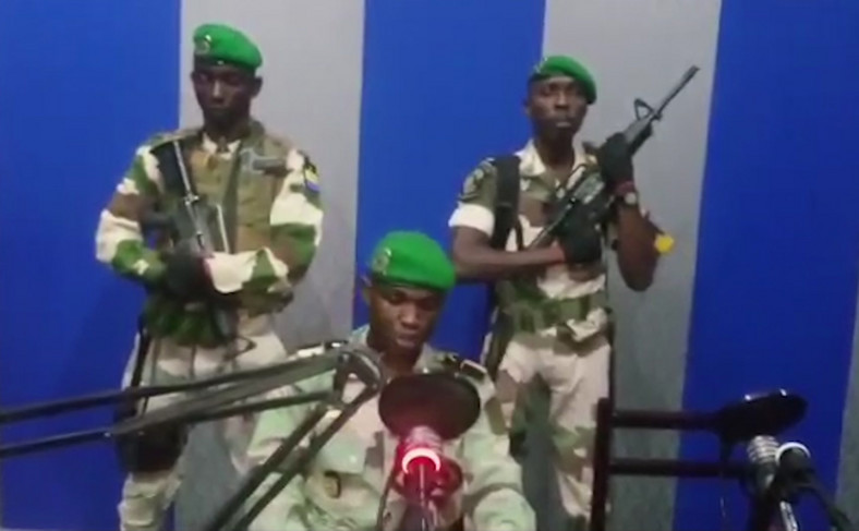 Gabonese military at a national radio station announcing coup