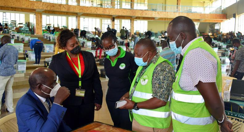 IEBC Chairperson Wafula Chebukati with elections officials at Mang'u Tallying Centre