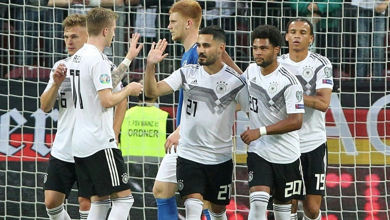 Ilkay Gundogan scored a penalty and created two other goals in Germany's 8-0 thrashing of Estonia on Tuesday