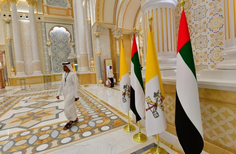 Vatican and Emirati flags stand in the UAE's presidential palace during the visit of Pope Francis