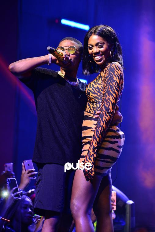 Wizkid and Tiwa Savage share a moment on stage at Wizkid's Lagos concert