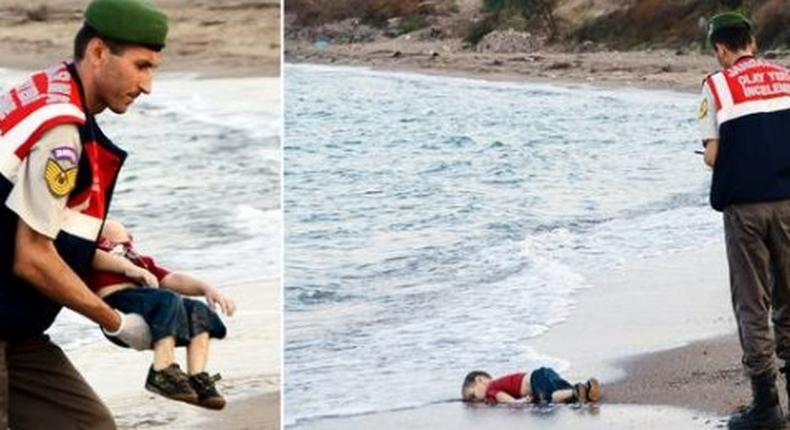 A government official finds the body of a drowned Syrian child washed ashore on Turkish beaches