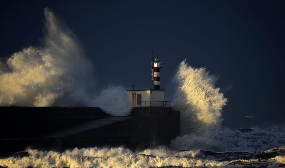 Huge waves crash on the San Esteban de Pravia seafront in the northern Spanish region of Asturias