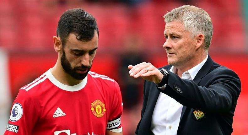 Manchester United boss Ole Gunnar Solskjaer consoles Bruno Fernandes after he missed a penalty in United's 1-0 defeat by Aston Villa Creator: Paul ELLIS