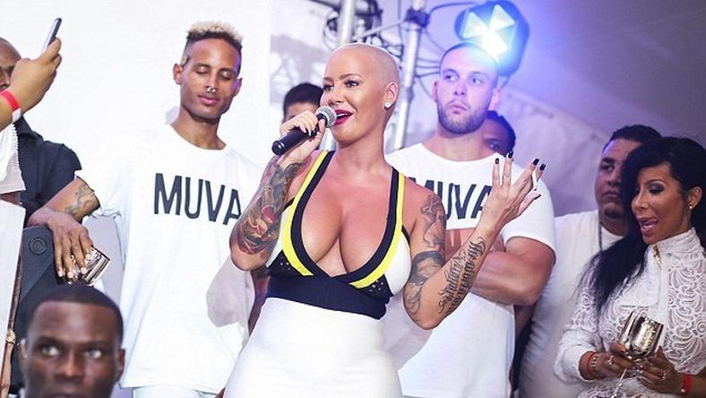 Amber Rose spills boobs on the Caribbean Island of Curacao