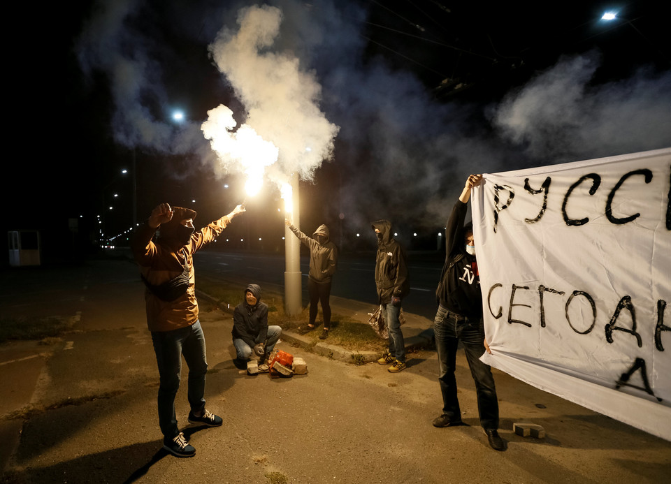 Protesters take part in a rally near the Russian embassy in Kiev