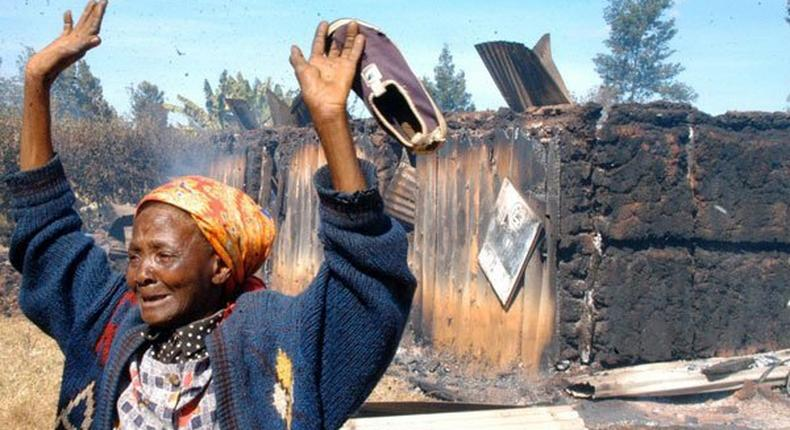 The widely shared photo of Elizabeth Wangui standing at the scene where 50 people were burnt to death at Kiambaa KAG Church