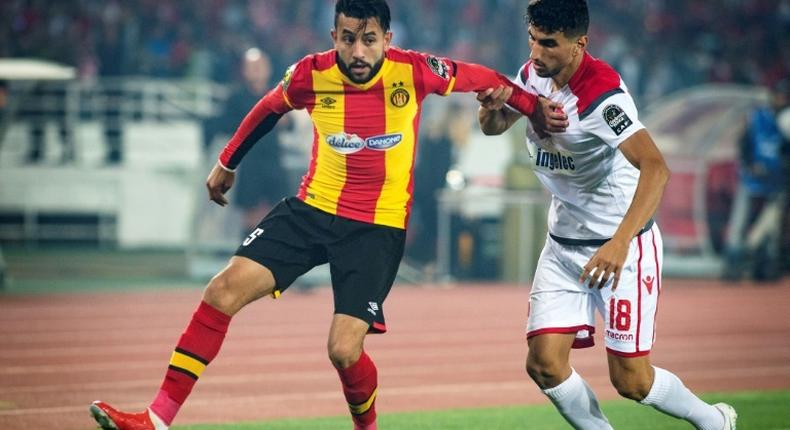 Ghailene Chaalali (L) of Esperance Tunis holds off Walid el Karti of Wydad Casablanca during the first leg of the 2019 CAF Champions League final in Rabat