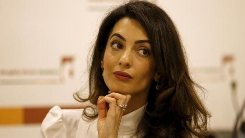 Lawyer Amal Clooney listens during a news conference for Mohamed Nasheed, in central London, Britain October 5, 2015. REUTERS/Peter Nicholls