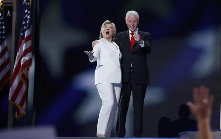 Democratic presidential nominee Hillary Clinton and her husband former president Bill Clinton react
