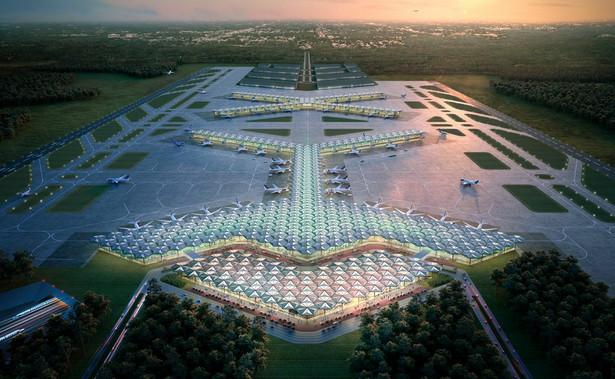 """Ta brytyjska pracownia zaproponowała budowę dwóch terminali: głównego podobnego do """"klucza"""" i uzupełniajacego w kształcie litery """"X"""", który miałby powstać w drugim etapie. Tym samym firma zaproponowała modułową budowę lotniska, które będzie można rozbudowywać w czasie i dostosowywać do potrzeb rosnącego ruchu lotniczego. Obie części mają być ze sobą zintegrowane (np. poprzez wahadłową kolejkę kursująca między terminalami), przy czym druga z nich powstanie, kiedy pojawi się zapotrzebowanie rynkowe na rozbudowę lotniska."""