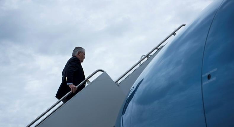 US Secretary of State Rex Tillerson boards his plane for a trip to Germany on February 15, 2017