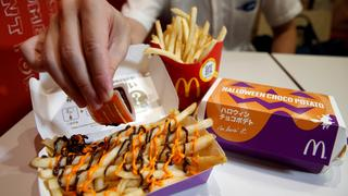 McDonald's Japan's 'Halloween Choco Fries - Pumpkin & Choco Sauce' that is McFry Potato served with pumpkin and chocolate sauces, is seen at a McDonald's restaurant in Tokyo