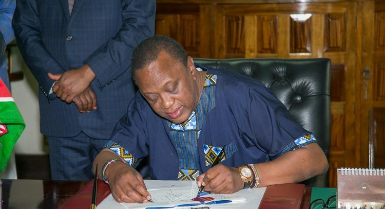 File image of President Uhuru Kenyatta. He has urged all public servants to wear at least one piece of apparel that is made in Kenya on Fridays