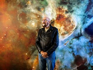 PASADENA - CA - NOVEMBER 11, 2014 - Astrophysicist Kip Thorne photograph in front of a stellar mural