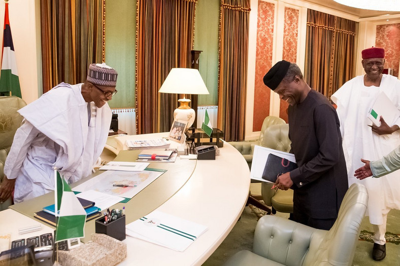 President Muhammadu Buhari and Vice President, Yemi Osinbajo share a joke in Buhari's office (Presidency)