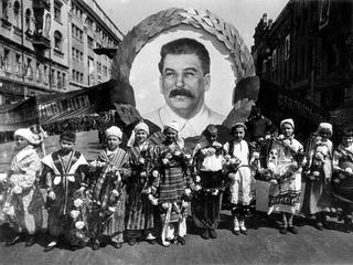 9th May 1938, Kiev, Russia, Children carry a portrait of Russian dictator and revolutionary Joseph S