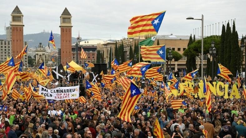Pro-independence demonstrators hold flags during a demonstration in Barcelona on November 13, 2016 against Spain's use of the courts to stop Catalonia's pro-independence aspirations