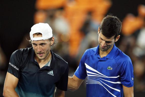 Luka Puj i Novak Đoković po završetku polufinala Australijan opena