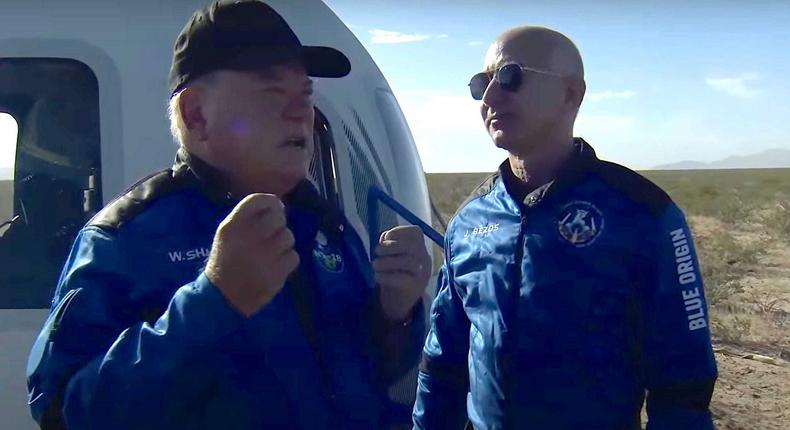 William Shatner tells Jeff Bezos about his spaceflight experience in a screenshot from Blue Origin's livestream.