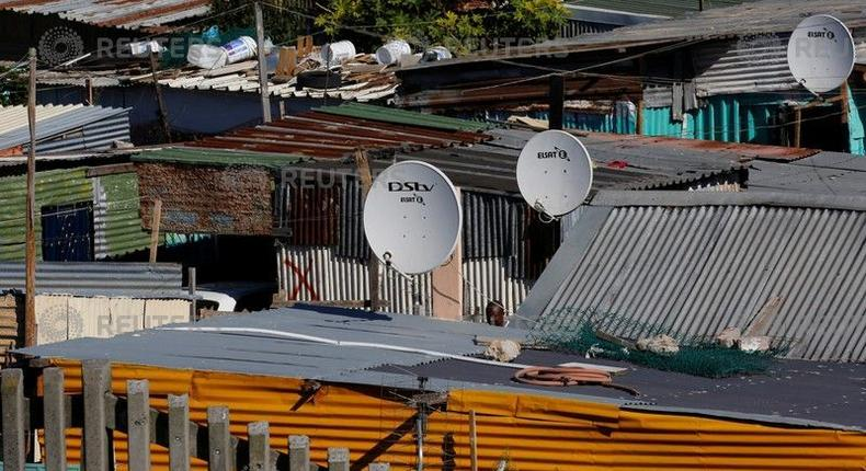 Satellite dishes connect township residents to South Africa's DSTV television network, owned by telecommunications giantNaspers, in Khayelitsha township, Cape Town, May 19, 2017.