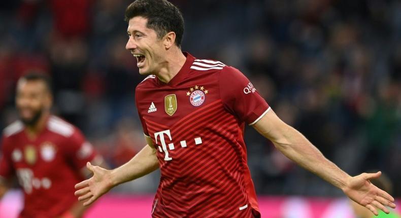 Bayern Munich striker Robert Lewandowski celebrates his hat-trick in the 5-0 thrashing of Hertha Berlin Creator: CHRISTOF STACHE