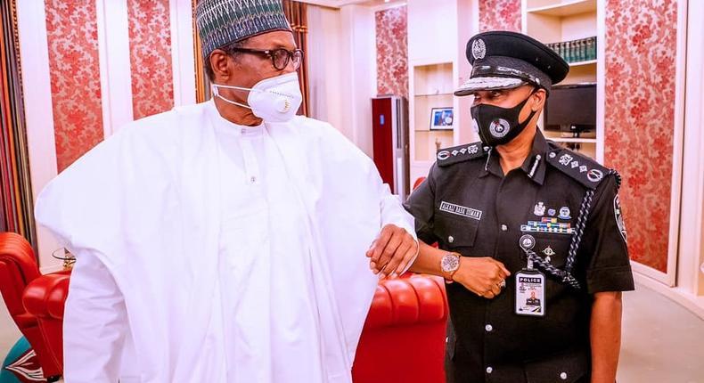 President Muhammadu Buhari (left) with the Inspector-General of Police, Usman Baba Alkali (right) [Presidency]